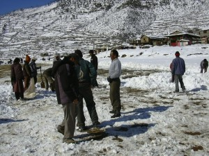Simikot airstrip with volunteers clearing snow